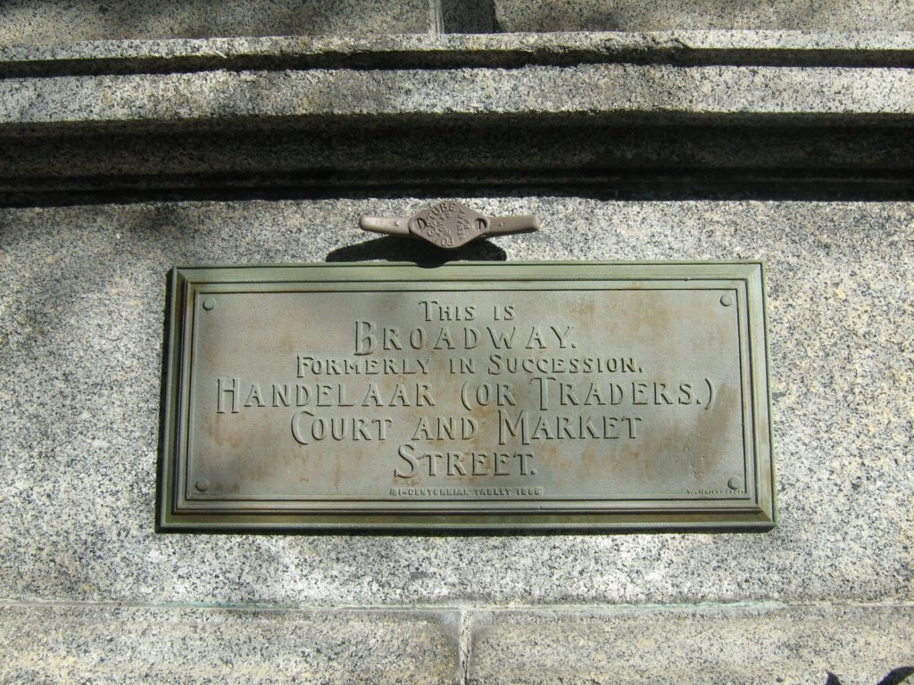 "Albany Bicentennial Tablet saying: ""This is Broadway. Formerly in succession, Handelaar (or Traders.) Court and Market Street."""