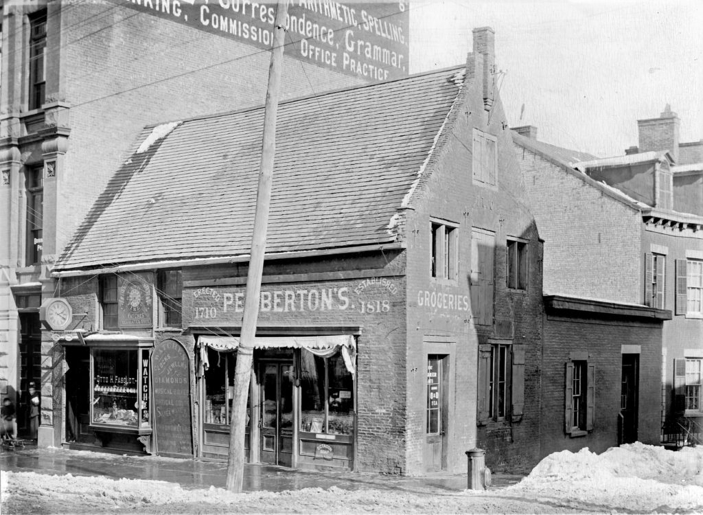 Detailed glass plate image of Pemberton's grocery store in Albany, formerly the Lansing house, about 1890.